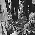 PRABHUPADA AND CHILD IN THE PARK.